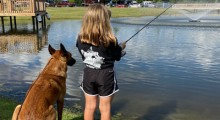 A Girl and Her Dog Fishing